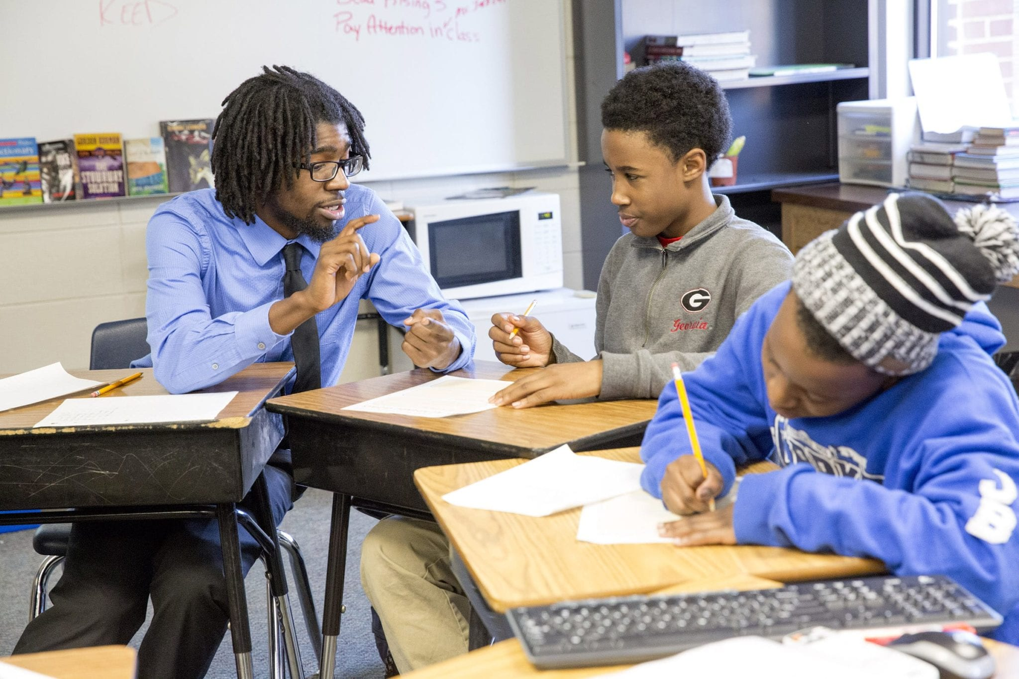 Mansur Ali Buffins coaches 6th grader Cordarious Williams on setting goals at Clarke Middle School. Photo by Dorothy Kozlowski